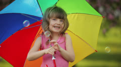 Child with umbrella playing the ape - stock footage