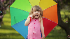 Little kid with umbrella laughing Stock Footage