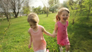 Stock Video Footage of Sisters running around in garden and laughing
