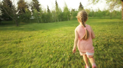 Sweet girl running away in the garden Stock Footage