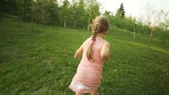 Sweet girl running away in the garden - stock footage