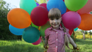 Stock Video Footage of Girl walking with balloons in the park and looking at camera