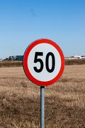 speed limit sign in rural setting - stock photo