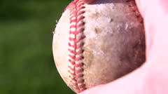 Turning baseball in hand slow motion Stock Footage