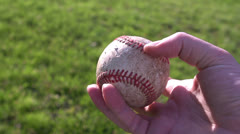 Walking with baseball in grass Stock Footage