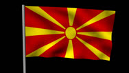 Zooming out from pyramid of men with rippling Macedonia flag animation Stock Footage