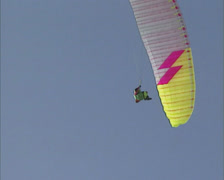 SWITZERLAND  para-glider in blue sky - low angle - stock footage