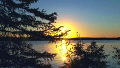 Sunset over Alaskan Lake with Lens Flares - Jib up Stock Footage