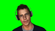 Man listening to music with headphones green screen Stock Footage