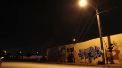 Graffiti Artist Painting Wall at Night Stock Footage