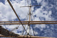 Sail schooner mast and sail ropes and gear blue sky Stock Photos