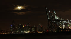 Moon Setting Behind Downtown Buildings Stock Footage