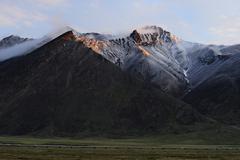 Snow mountain and pipeline Stock Photos