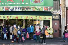 Chinatown vegetable market people on street Stock Photos