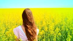 Beautiful Young Woman Standing in a Yellow Field Slow Motion HD Stock Footage