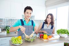 couple in kitchen - stock photo