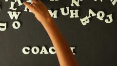A person spelling Coaching - stock footage