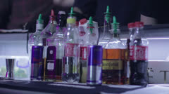Serving drinks at night club party, carrying sliced oraged Stock Footage