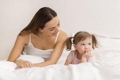 little girl .sulking  with her mother. - stock photo