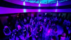 Dancing people flying camera in night club during party - stock footage