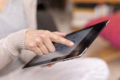 Woman hand touching screen on digital tablet. Stock Photos
