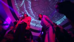 Low angle shot of dancing people during party in night club Stock Footage