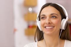 young woman listening to music at home - stock photo