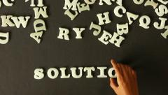 A person spelling Solutions - stock footage