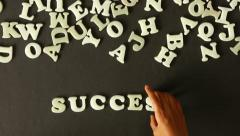 A person spelling Success - stock footage