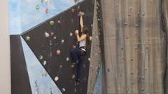 Climber woman climbing a wall Stock Footage