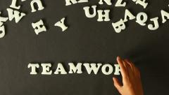 A person spelling Teamwork - stock footage