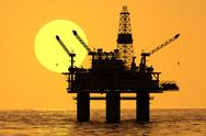 Stock Illustration of Oil platform rig on sea drilling for oil. Petrol industry offshore gas sunset