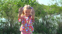 Child with Dirty Hands Looking and Smiling at Camera, Girl Playing, Children Stock Footage