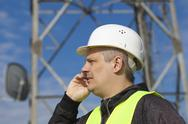Engineer talking on the cell phone near to gsm tower Stock Photos