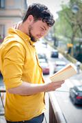 Young man reading book Stock Photos