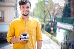 Hipster young man with polaroid Stock Photos