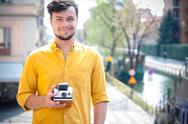 Stock Photo of hipster young man with polaroid