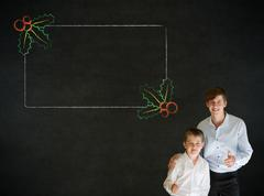 thumbs up boy business man and teacher with christmas holly checklist - stock photo