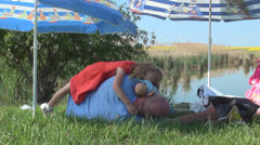 Sleeping Girl on his Father at a Fishing Lake, Resting Family, Sleepy Child Stock Footage