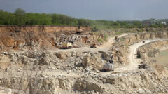 Production of a natural construction stone in an open pit. Working excavators. Stock Footage