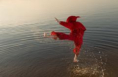 Karate monk wearing red hood Stock Photos