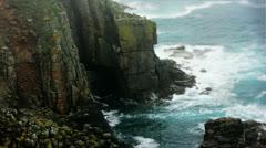 Cave Arch Atlantic Ocean Sea Rock Coast Rainy Foggy Seagull - 29,97FPS NTSC Stock Footage