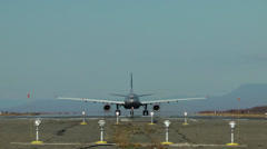 Movement of hard loaded big passenger plane on a runway Stock Footage