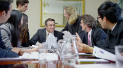 Ecstatic business team in elegant office throw documents and papers into the air - stock footage