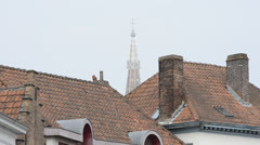 Tiled roofs and spire of Church of Our Lady in Bruges, Belgium Stock Footage