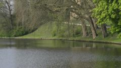 Water tower and canal near Gentpoort in Bruges, Belgium Stock Footage