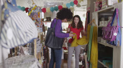 Happy and attractive young women shopping together  Stock Footage