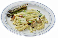 a meal of chicken, pasta and broccoli in alfredo sauce with fresh organic asp - stock photo