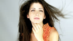 Gorgeous fashion model with blowing hair sending kiss slow motion Stock Footage