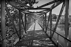 old style iron river bridge - stock photo
